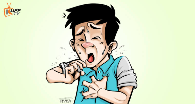 Picture of a person sneezing or coughing
