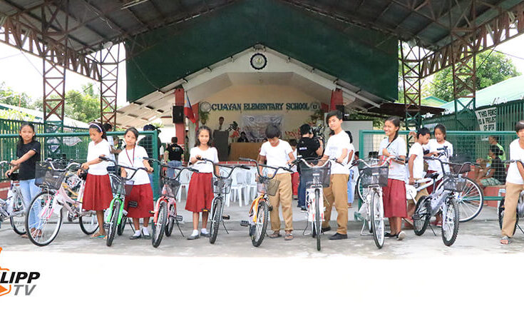 students enjoying their new bike