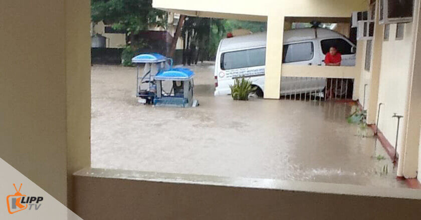 The boy, staring at something, was standing next to the ambulance, which fortunately did not sink in the knee-deep flood, unlike the tricycle, Dinalupihan District hospital